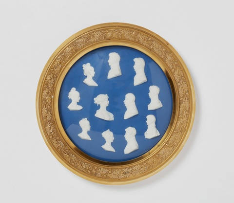 A framed Berlin KPM porcelain plaque with portraits of the Prussian royal family -