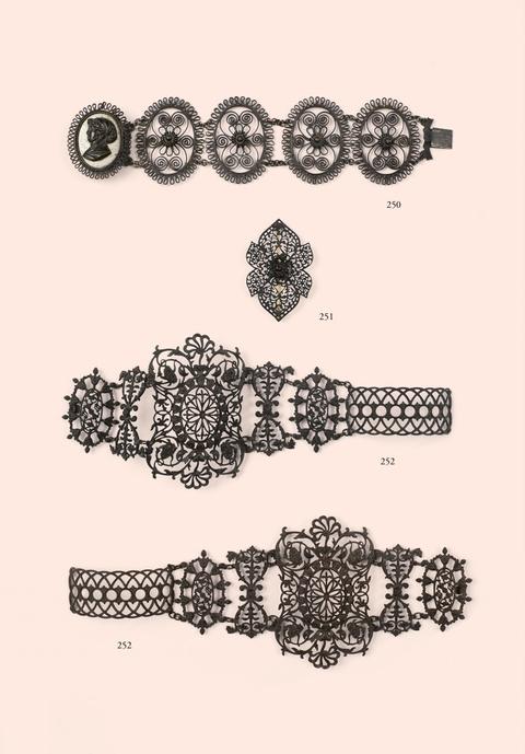 A pair of cast iron bracelets -