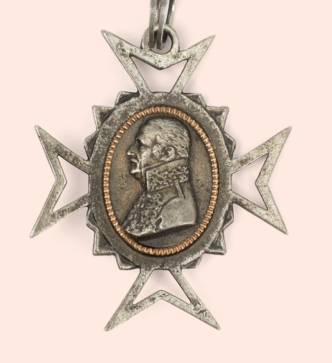 A cast iron necklace with a cross pendant and portraits of General Blücher and the Duke of Wellington -