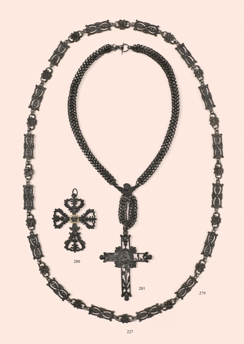 A cast iron necklace with a cross pendant -