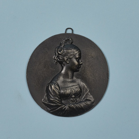 A round cast iron plaque with Princess Luise as a young girl -