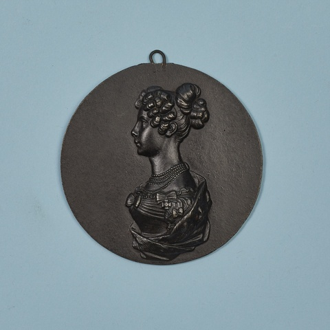 A round cast iron plaque with Princess Luise -