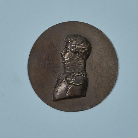 A round cast iron plaque with a portrait of Prince Friedrich Wilhelm Ferdinand Radziwill -