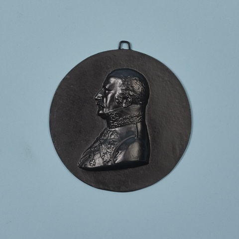 A round cast iron plaque with a portrait of General Field Marshall Blücher -