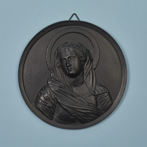 A cast iron plaque with the Virgin Mary -