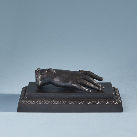 A cast iron ladies hand paperweight -