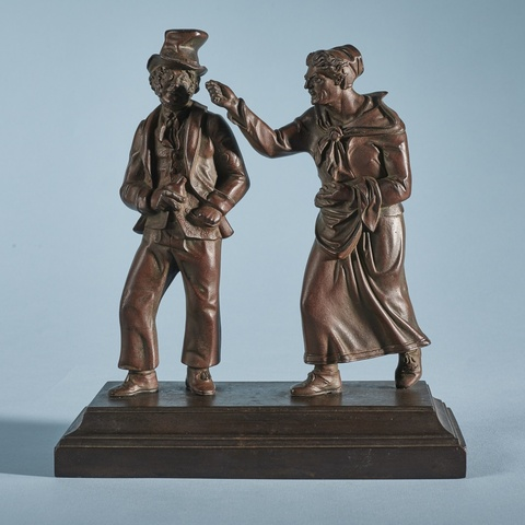 Two cast iron figures of typical Berlin caricatures -