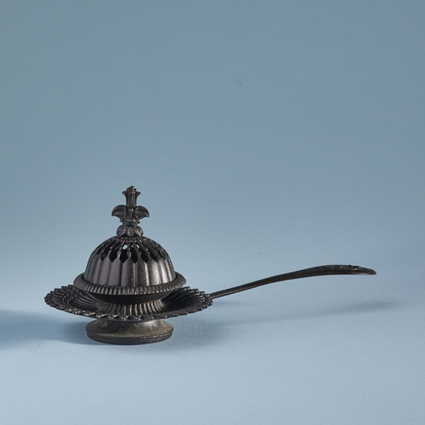 A cast iron incense burner -