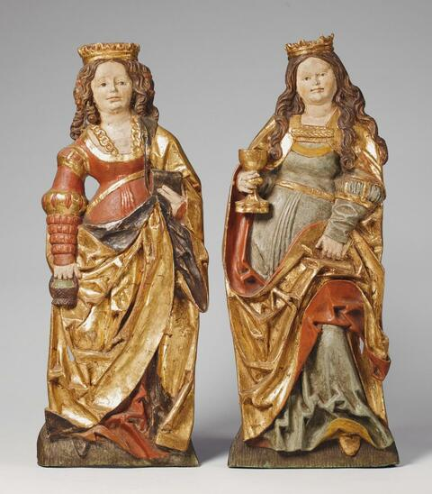 Swabia, second half 15th Century - A PAIR OF SWAIBAN CARVED WOOD HIGH RELIEF FIGURES OF SAINT DOROTHEA AND SAINT BARBARA, SECOND HALF 15TH CENTURY