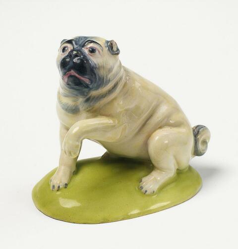 A Höchst faience figure of a pug. -
