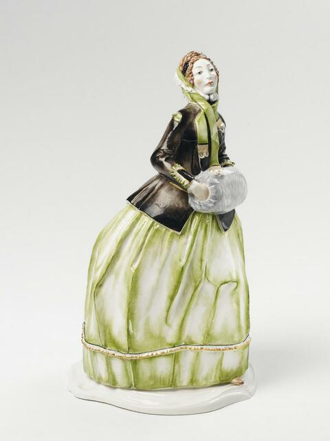 A Nymphenburg figure of a lady in a muffler, -