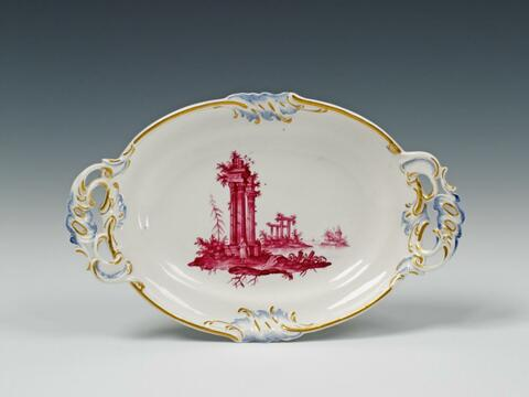 A small Höchst rocaille-form dish with painted ruins. -