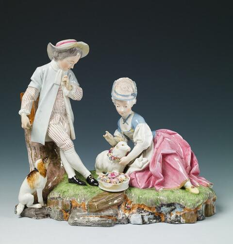 A Höchst group of a shepherd, dog and lamb on an earth mound base. -