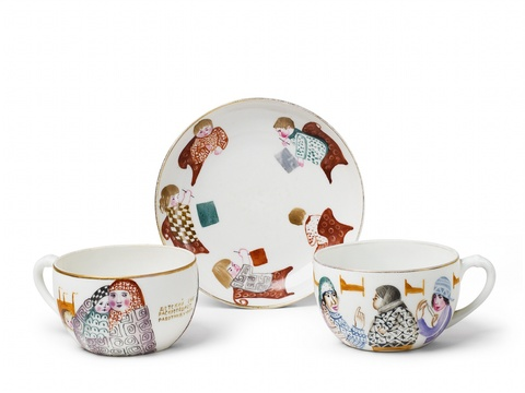 "Two porcelain cups and one saucer, inscribed ""Thanks to the crèche, mothers are able to work"". -"