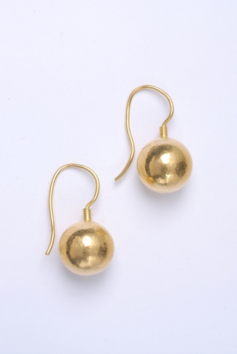 A pair of hand forged 24k gold earrings. -