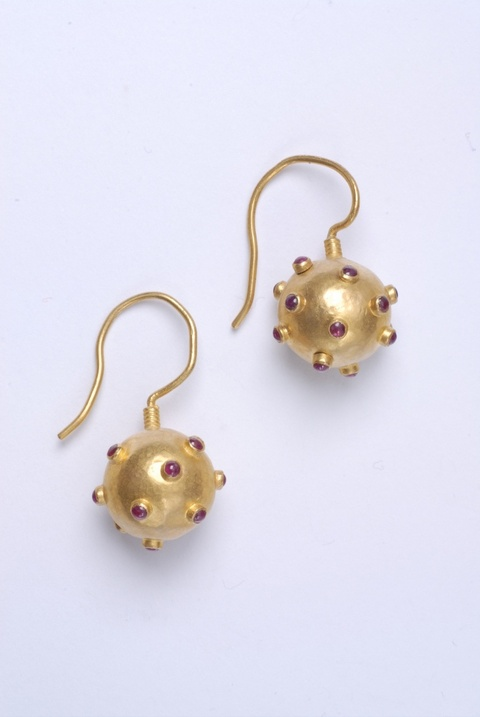 A pair of hand forged 24k gold and ruby hook earrings -