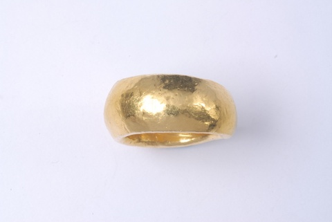 A hand forged 24k gold ring. -