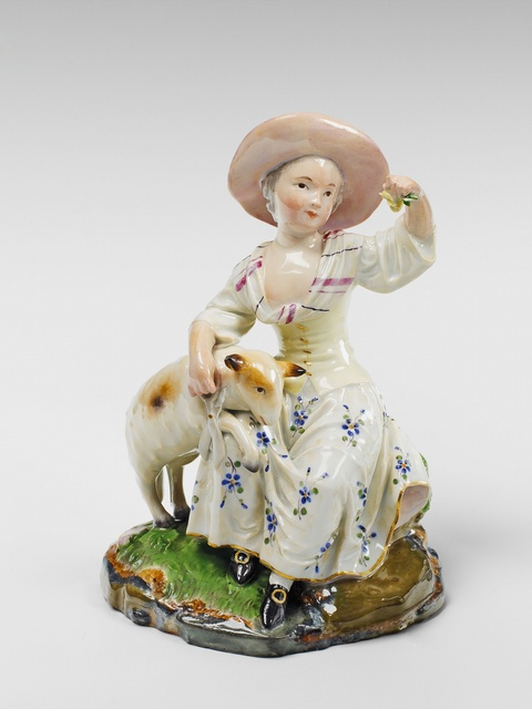 A Höchst porcelain group of a girl shearing a lamb. -