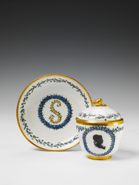A Höchst porcelain neoclassical covered cup and saucer. -