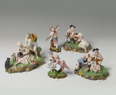A Höchst porcelain figure of a girl milking a goat. -