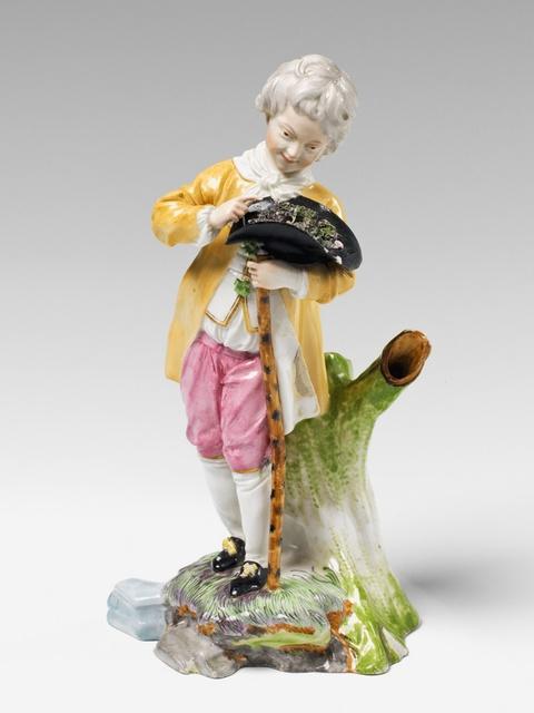 A Höchst porcelain figure of a boy with a bird's nest. -