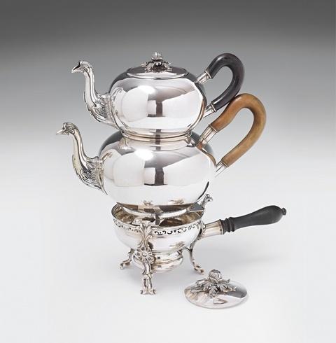A Brunswick silver teapot and rechaud -