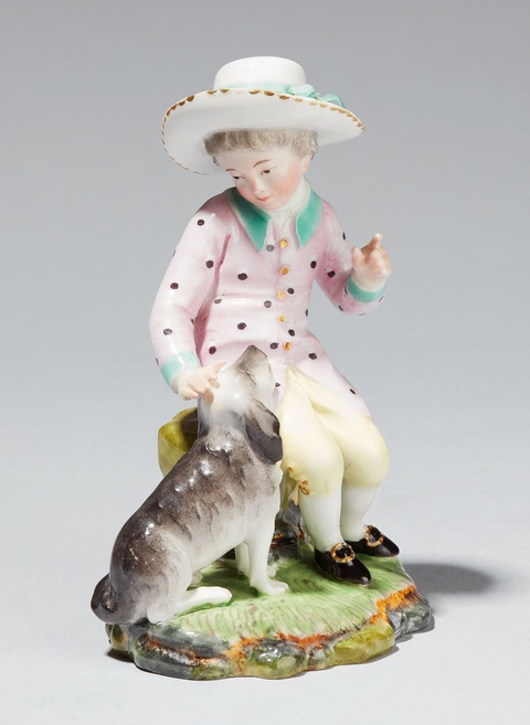 A Höchst porcelain figure of a boy with a dog -