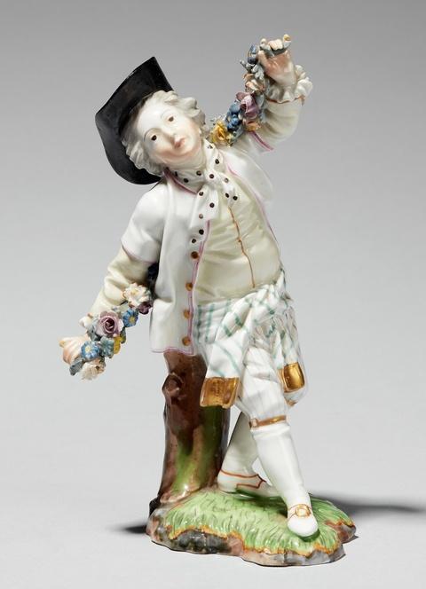 A Höchst porcelain model of a dancer with a garland -