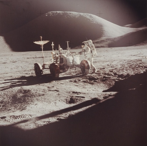 NASA - Apollo 15, Astronaut James B. Irwin works at the Lunar Roving Vehicle