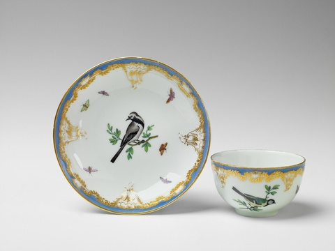 Teetasse mit Vogelmalerei -