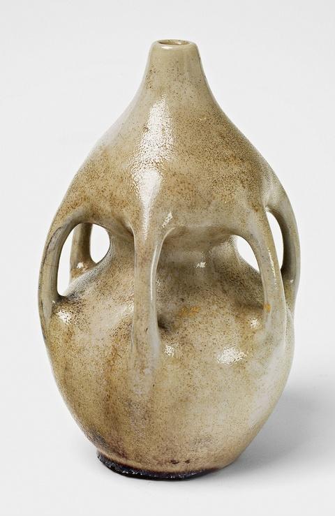A beige gourd-form feldspar and copper glazed stoneware vase -