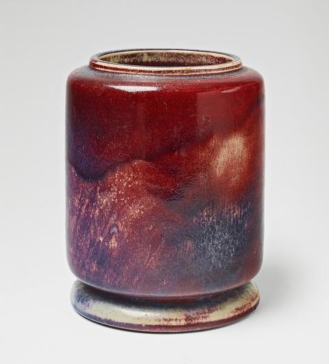 A cylindrical copper-red feldspar glazed stoneware vase -