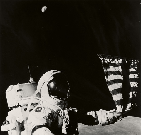 NASA - Apollo 17, Astronaut Eugene A. Cernan adjusts the flag planted on the Moon