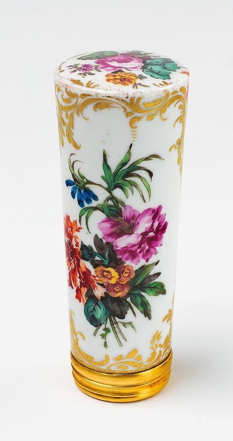 A porcelain cane handle with floral decor -