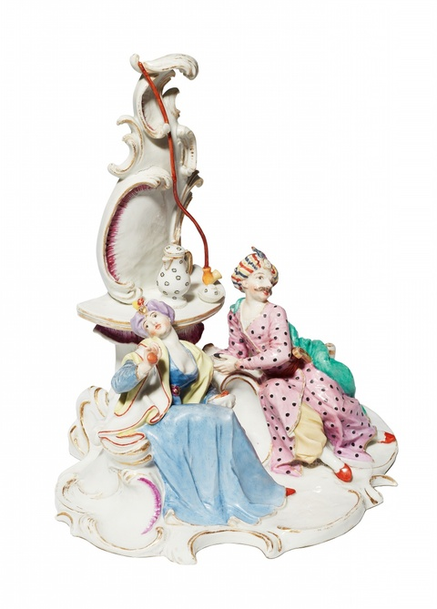A Nymphenburg porcelain group with a Turkish couple taking coffee -