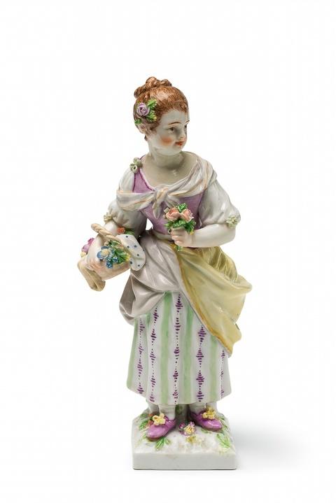 Gärtnermädchen mit Blumenkorb -