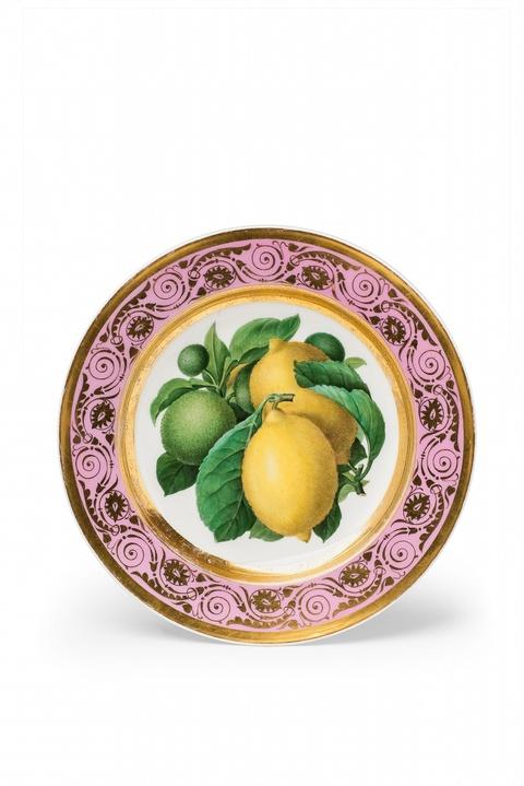Obstteller mit Zitronen und Limonen -