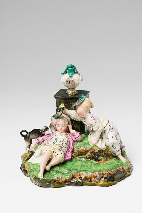 A Höchst porcelain figure group with a sleeping boy -