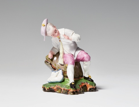 A Höchst porcelain figure of a boy at rest -