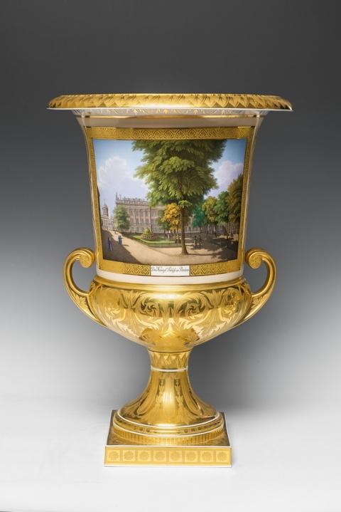 A Berlin KPM porcelain urn with views of Potsdam -