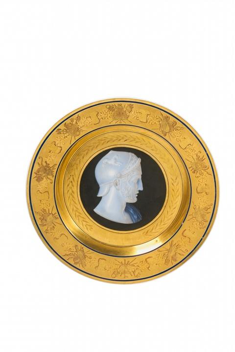 A Berlin KPM porcelain plate with a cameo portrait of Achilles -