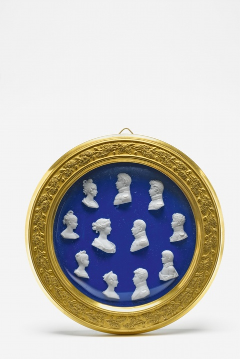 A Berlin KPM porcelain tondo with relief busts of the Prussian royal family -