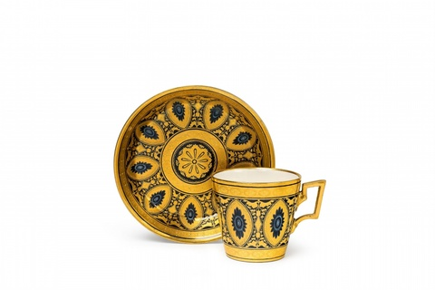 A Vienna porcelain cup and saucer with arabesque decor -