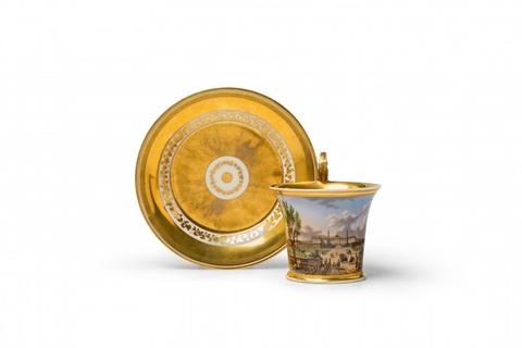 A Vienna porcelain cup and saucer with a view of Schönbrunn Castle -