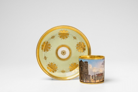 A Vienna porcelain cup and saucer with a view of the Schottenkirche -