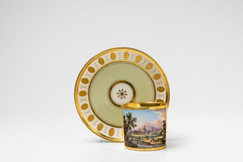 A Vienna porcelain cup and saucer with a view of Mödling -