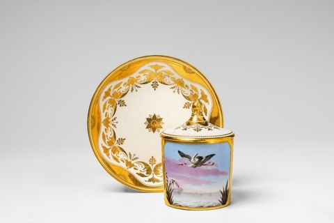 A Vienna porcelain cup and cover with a pair of storks -