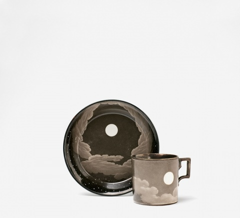 A Vienna porcelain cup and saucer painted with the night sky -