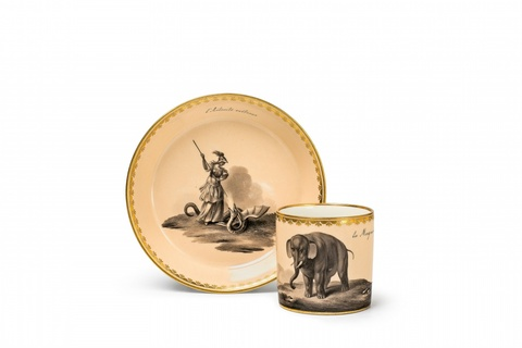 A Vienna porcelain allegorical cup and saucer with an elephant -