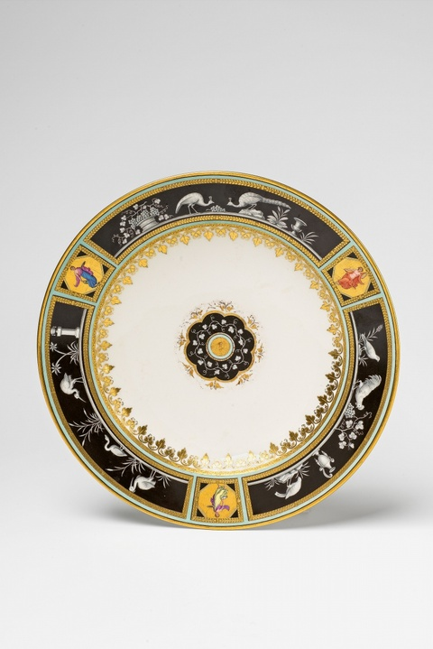 A Vienna porcelain plate in the style of Herculaneum -